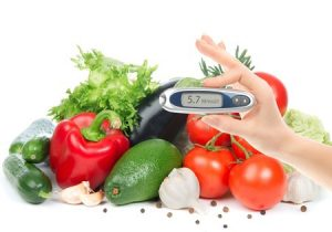 diabetes glucometer for glucose level blood test in hand and healthy organic food